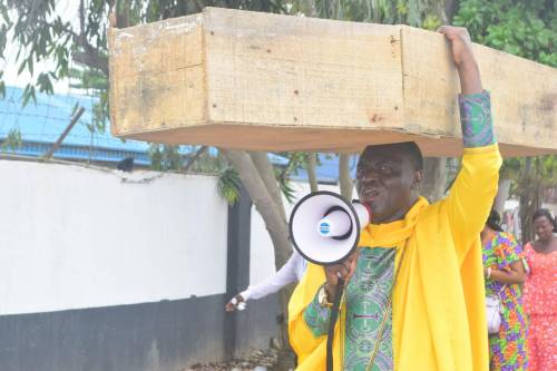 Lagos-Based Pastor Carries Coffin, Says God Not Happy With Buhari Government